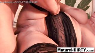Aged big beautiful woman takes a load on her biggest natural breasts