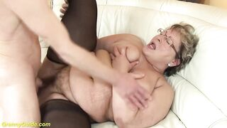 Chunky golden-haired granny in ebony nylons is getting her curly twat fucked on the bed