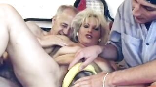 Indecent granny is riding a youthful guy's massive knob, whilst her slutty spouse is watching
