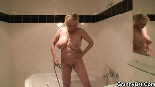 Breasty Golden-Haired Granny Pleases him after Shower