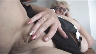 Overweight English golden-haired with glasses is fingering her perfectly hairless twat and enjoying it a lot