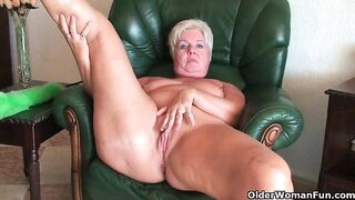 Overweight, golden-haired granny took off her red underware and started playing with her perfectly bald cunt