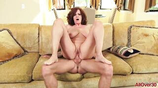 Andi James is a smashing redhead with large boobs, who loves to have sex with younger lads